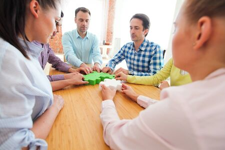 Hipster business successful teamwork concept, business people group assembling jigsaw puzzle