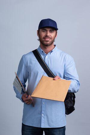 Postman Delivering Mail delivery man giving envelope Stock fotó
