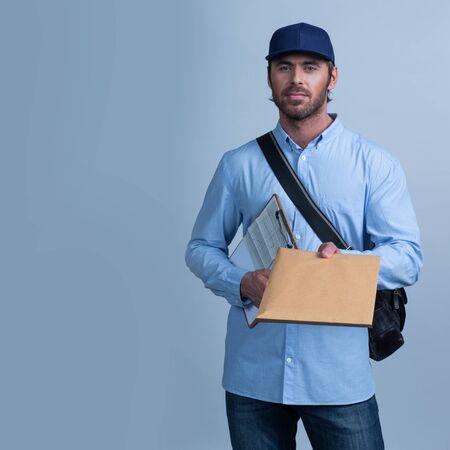 Postman Delivering Mail delivery man giving envelope Reklamní fotografie