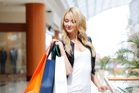 Fashion shopping woman walking with bags in shopping mall