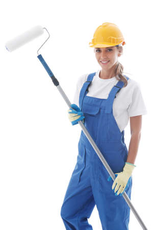 Female house painter in blue uniform coveralls and yellow hardhat with paint roller isolated on white background