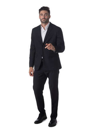 Full length portrait of young handsome business man pointing to the camera isolated on white background, business people Imagens