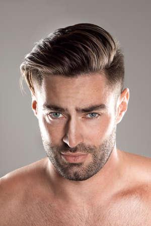 Closeup portrait of a beautiful male model, caucasian man with dark hair and gray eyes 版權商用圖片