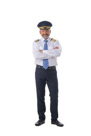 Airline first pilot, aircraft commander, standing with arms folded isolated on white background, full length portrait Standard-Bild