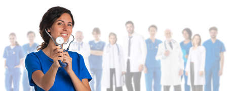 Healthcare and medical concept - group of doctors isolated on white background, woman withc stethoscope pointing to you
