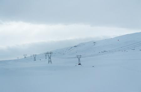 describing: Photo taken on a winter day landscape and Energy describing the lines.