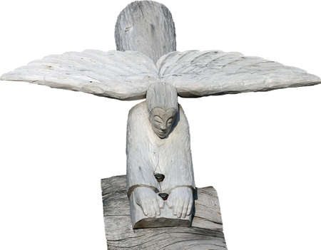wooden figure: separated abstract figure of an wooden figure like an angel going down on a pedestal
