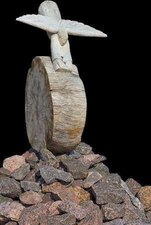 angel flying: separated abstract figure of an wooden figure like an angel flying and rolling down from the stone mountain