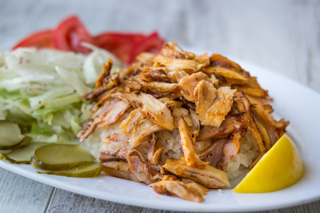 Turkish Chicken Doner Kebab with rice in a white plate. Stock Photo