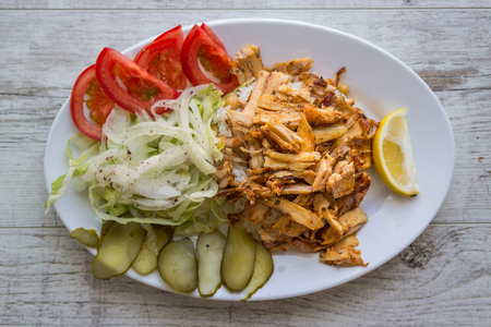 Turkish Chicken Doner Kebab with rice in a white plate. Stock Photo - 84592948