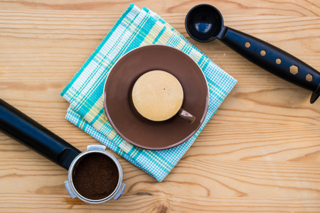 Espresso cup with handle, metal spoon and tamper Stock Photo