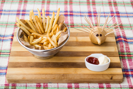 Fried potatoes with ketchup and mayonnaise