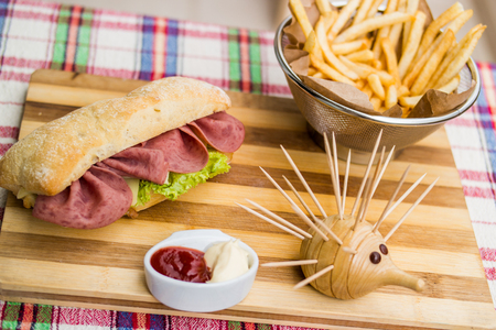 Ham sandwich with fried potatoes, ketchup and mayonnaise. Stock Photo - 84746513