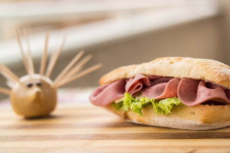 Ham sandwich on a wooden surface