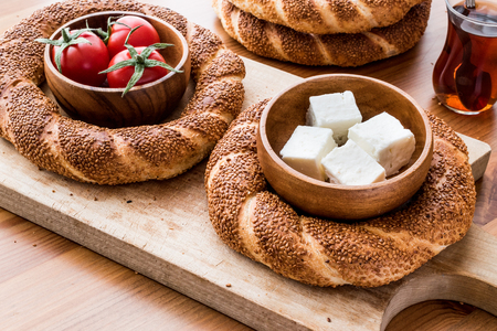 Turkish Bagel Simit with tea, cheese and cherry tomatoes. (ramadan concept) Standard-Bild
