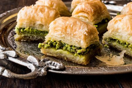 baklava: Turkish Dessert Baklava with pistachio on silver tray. Dessert Concept. Stock Photo