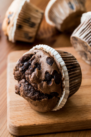 blueberry muffin: Chocolate and Vanilla Muffins on wooden surface. dessert concept. Stock Photo