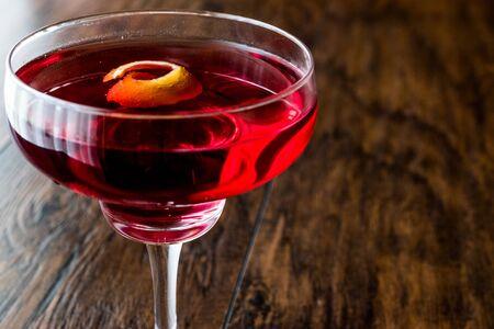 Boulevardier cocktail with lemon peel. Beverage Concept.
