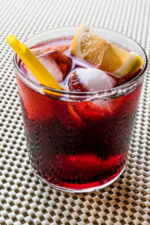 sweet vermouth: Americano Cocktail with lemon and ice. Beverage Concept. Stock Photo