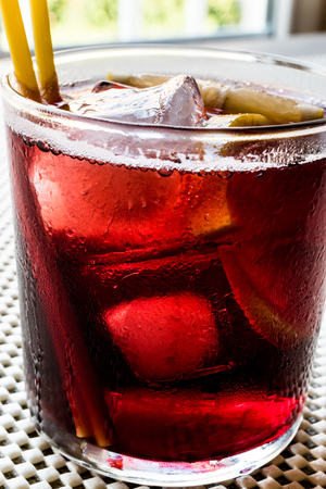 Americano Cocktail with lemon and ice. Beverage Concept. Stock Photo