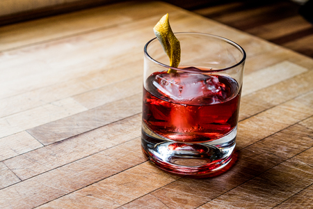 Negroni Cocktail with lemon peel and ice. Beverage Concept. Stock Photo