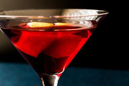 sweet vermouth: Manhattan Cocktail with orange peel. Beverage Concept. Stock Photo