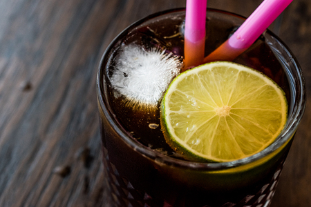 Whiskey Cola Cocktail with lime and ice. (cuba libre). Beverage concept. Stock Photo