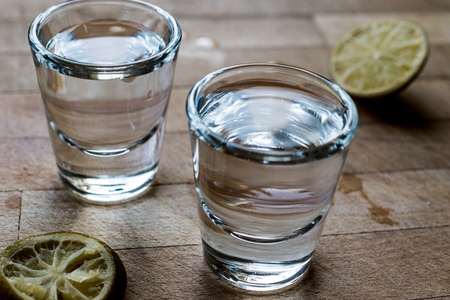 Mezcal Tequila Shots with Lime and Salt. Beverage Concept. Archivio Fotografico