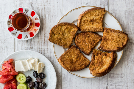 Turkish Egg Bread with tea  Yumurtali ekmek  French Toast. Traditional Breakfast.