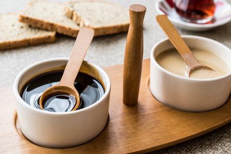 Turkish Tahin Pekmez / Tahini and Molasses with tea. breakfast concept.