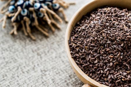 Harmal seed or Peganum harmala  uzerlik otu  Erowid Syrian Rue. Organic Concept. Stock Photo