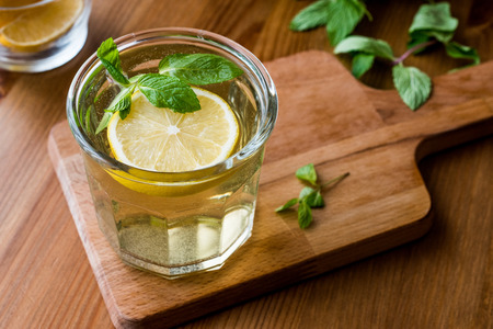 Homemade ice tea with lemon and mint leaves. Organic Beverage