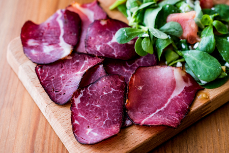 Smoked and Dried Meat Slices with salad  kuru et. Organic Food. Stock Photo