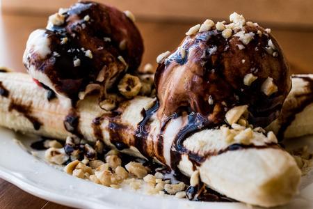 Banana Split with ice cream chocolate sauce and Hazelnuts. Dessert Concept. 스톡 콘텐츠