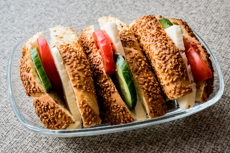 Turkish Bagel Simit Sandwich with cheese, tomato and cucumber. fast food