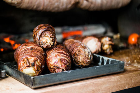 Turkish Street Food Kokorec made with sheep bowel cooked in wood fired oven. fast food. Stock Photo