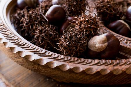 Horse Chestnuts in wooden basket. Organic Food. 版權商用圖片