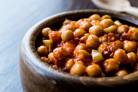 Chana Masala Chickpeas in wooden bowl. Traditional Food.