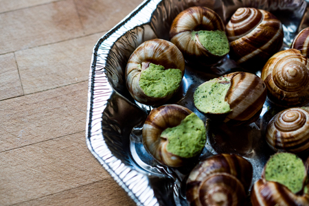 Frozen Snail food with Garlic Butter. Organic Food.