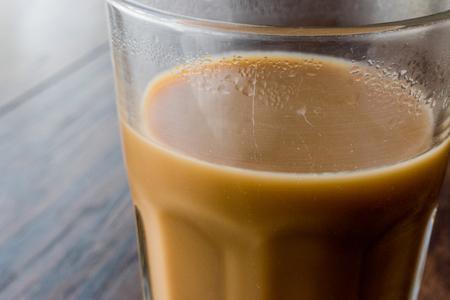 Masala Chai Tea in a big glass. Beverage Concept. Imagens