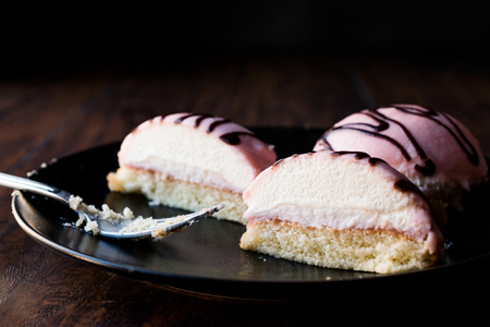 Half Sliced Cut Pink Princess Cream Cake with Almond Paste  Marzipan and Chocolate Sauce. Traditional Dessert.