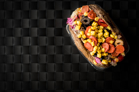 Kumpir  Turkish Baked potato with cheese, corn and sausage copy space. fast food