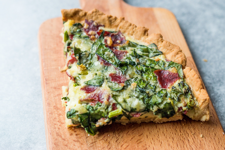 Quiche with Spinach, Chard, Pastrami and Cheese. Traditional Food. Stock Photo