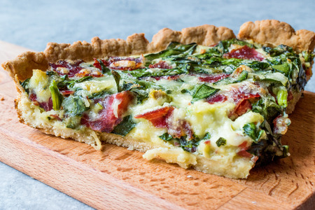 Quiche with Spinach, Chard, Pastrami and Cheese. Traditional Food. Фото со стока