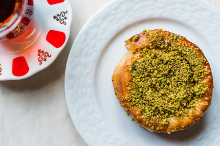 Turkish Konya Dessert Sac Arasi with Pistachio Powder  Kunefe Kadayif or Katmer. Traditional Dessert.