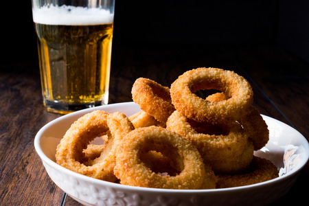 Homemade Crunchy Fried Onion Rings with Beer. Fast Food.