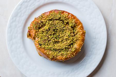 Turkish Konya Dessert Sac Arasi with Pistachio Powder  Kunefe Kadayif or Katmer. Traditional Dessert.
