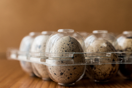 Quail Eggs in plastic box / carrier (organic food concept)