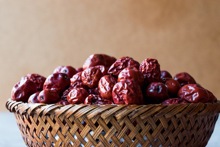 Red Jujube Fruits in Wooden Basket. Organic Food.