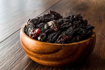 Organic Dried Raw Raisins in Wooden Bowl. Organic Food.